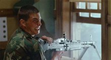 "A young Tom Cruise loving his machine gun in ""Taps"""