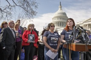 A grieving Laura Christian (far right) appeals to GM and America for justice (J. Scott Applewhite/AP)