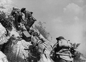 Polish troops carrying ammo at Monte Cassino