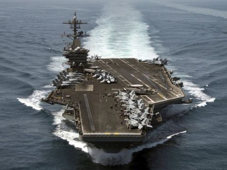 Send in the heavily-armed carriers.  It's about peace!