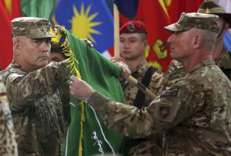"""Commander of the International Security Assistance Force (ISAF), Gen. John Campbell, left, and Command Sgt. Maj. Delbert Byers open the """"Resolute Support"""" flag during a ceremony at the ISAF headquarters in Kabul, Afghanistan, Sunday, Dec. 28, 2014. The United States and NATO formally ended their war in Afghanistan on Sunday with the ceremony at their military headquarters in Kabul as the insurgency they fought for 13 years remains as ferocious and deadly as at any time since the 2001 invasion that unseated the Taliban regime following the Sept. 11 attacks. (AP Photo/Massoud Hossaini)"""